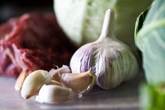 Garlic. Photo of garlic on plastic board Royalty Free Stock Photos