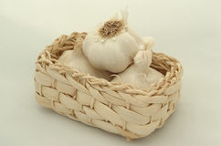 Garlic. In a small white basket royalty free stock photography