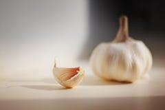 Garlic. On kitchen table, macro closeup Stock Photo