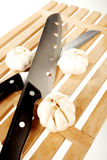 Garlic And Two Knifes Stock Image