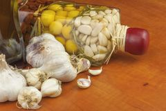 Garlic, aromatic ingredients for flavoring food. Home remedy for colds and flu. Garlic marinated in olive oil. Royalty Free Stock Image