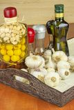 Garlic, aromatic ingredients for flavoring food. Home remedy for colds and flu. Garlic marinated in olive oil. Stock Photography