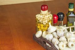 Garlic, aromatic ingredients for flavoring food. Home remedy for colds and flu. Garlic marinated in olive oil. Stock Photo