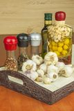 Garlic, aromatic ingredients for flavoring food. Home remedy for colds and flu. Garlic marinated in olive oil. Royalty Free Stock Photos