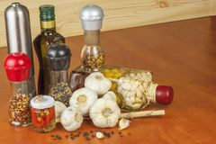 Garlic, aromatic ingredients for flavoring food. Home remedy for colds and flu. Garlic marinated in olive oil. Stock Image