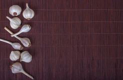 Garlic. On a background of bamboo Stock Photos