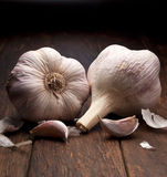 Garlic Background. A still life with garlic bulbs on a wood background royalty free stock photos