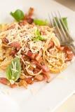 Garlic bacon spaghetti. Fresh spaghetti with garlic, bacon, parmezan and basil Stock Photos