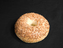 Garlic Bagel. From above on Black Fabric royalty free stock images
