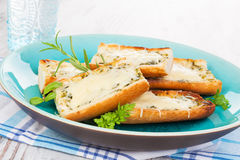 Garlic baguette with melted cheese. Royalty Free Stock Photos