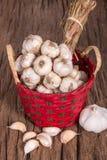 Garlic on Bambboo Basket Royalty Free Stock Photos
