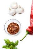 Garlic basil and paprika. Three garlic bulbs, paprika and basil isolated on white Royalty Free Stock Photo