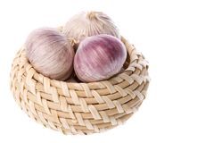 Garlic in basket Royalty Free Stock Photography