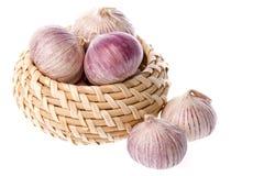 Garlic in basket Stock Photography