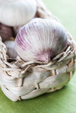 Garlic in a basket on cloth Stock Photography