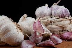 Garlic basket. A lot of healthy and delicious garlic in the basket Royalty Free Stock Photography