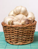 Garlic on basket. Some garlic heads on a basket container Stock Images