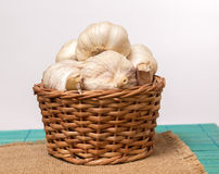 Garlic on basket. Some garlic heads on a basket container Royalty Free Stock Image