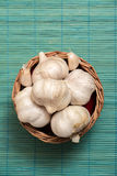 Garlic on basket Royalty Free Stock Images
