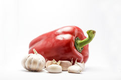 Garlic and bell pepper. Garlic and red bell pepper isolated Stock Photography