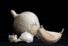 Garlic on black background Royalty Free Stock Images