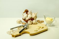 Garlic on a board with sauce Stock Image