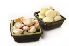 Garlic in bowl Stock Images