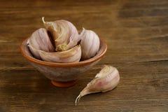 Garlic in bowl Stock Photos