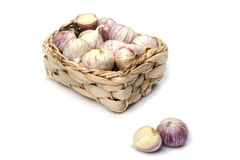 Garlic in box on white Royalty Free Stock Images