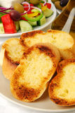 Garlic bread. Served with Greek salad stock photography