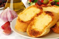 Garlic bread. Delicious garlic bread on a plate royalty free stock photo