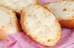 Garlic bread. Closeup of slices of cooked garlic bread Stock Photos