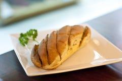 Garlic bread. On disk in restuarant light Royalty Free Stock Photos