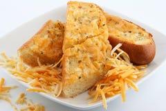 Garlic bread. Oven baked garlic bread in plate Stock Photos