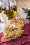 Garlic Bread Appetizer. Some Garlic Bread pieces on wooden background royalty free stock photography