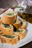 Garlic Bread Appetizer. Some Garlic Bread pieces on wooden background stock photography