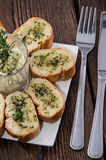 Garlic Bread Appetizer. Some Garlic Bread pieces on wooden background stock image