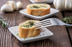 Garlic Bread Appetizer. Some Garlic Bread pieces on wooden background royalty free stock images