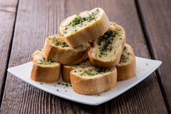 Garlic Bread Appetizer. Some Garlic Bread pieces on wooden background stock images