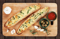 Garlic bread with butter and rosemary Stock Images
