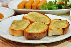 Garlic bread close-up. Close-up,Garlic bread on white plate royalty free stock photos