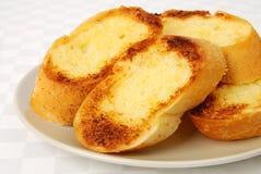 Garlic bread closeup. Garlic bread on bright background royalty free stock photo