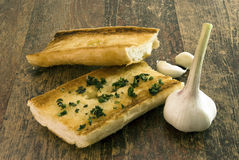 Garlic bread with clove. Lying on wood stock image
