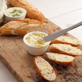 Garlic bread compound butter herb baguette thyme rosemary coriander oregano Royalty Free Stock Images