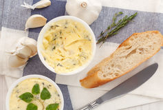 Garlic bread compound butter herb baguette thyme rosemary coriander oregano. Fresh chopped homemade italian food snack tasty Royalty Free Stock Photography