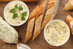 Garlic bread compound butter herb baguette thyme rosemary coriander oregano. Fresh chopped homemade italian food snack tasty Stock Photos