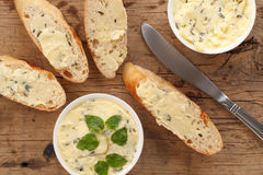 Garlic bread compound butter herb baguette thyme rosemary coriander oregano. Fresh chopped homemade italian food snack tasty Royalty Free Stock Photos