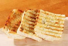 Garlic bread with cutting board Stock Photos