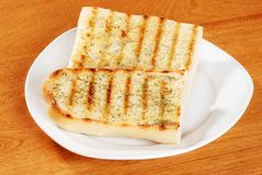 Garlic bread with herbs Stock Photos
