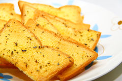Garlic bread with herbs stock photo